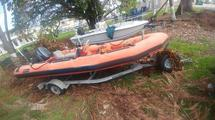 CG-182527 WITH OUTBOARD MOTOR AND TRAILER