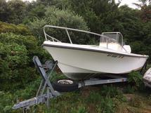 MAKO BOAT WITH TRAILER AND 135 HP MERCURY ENGINE