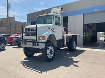 2002 INTERNATIONAL 4700,T44E,WITH HYD/CABLE /ARM