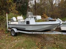 17   BOAT WITH MOTOR AND TRAILER
