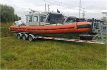 CG-25509 WITH TWIN OUTBOARDS AND BOAT TRAILER